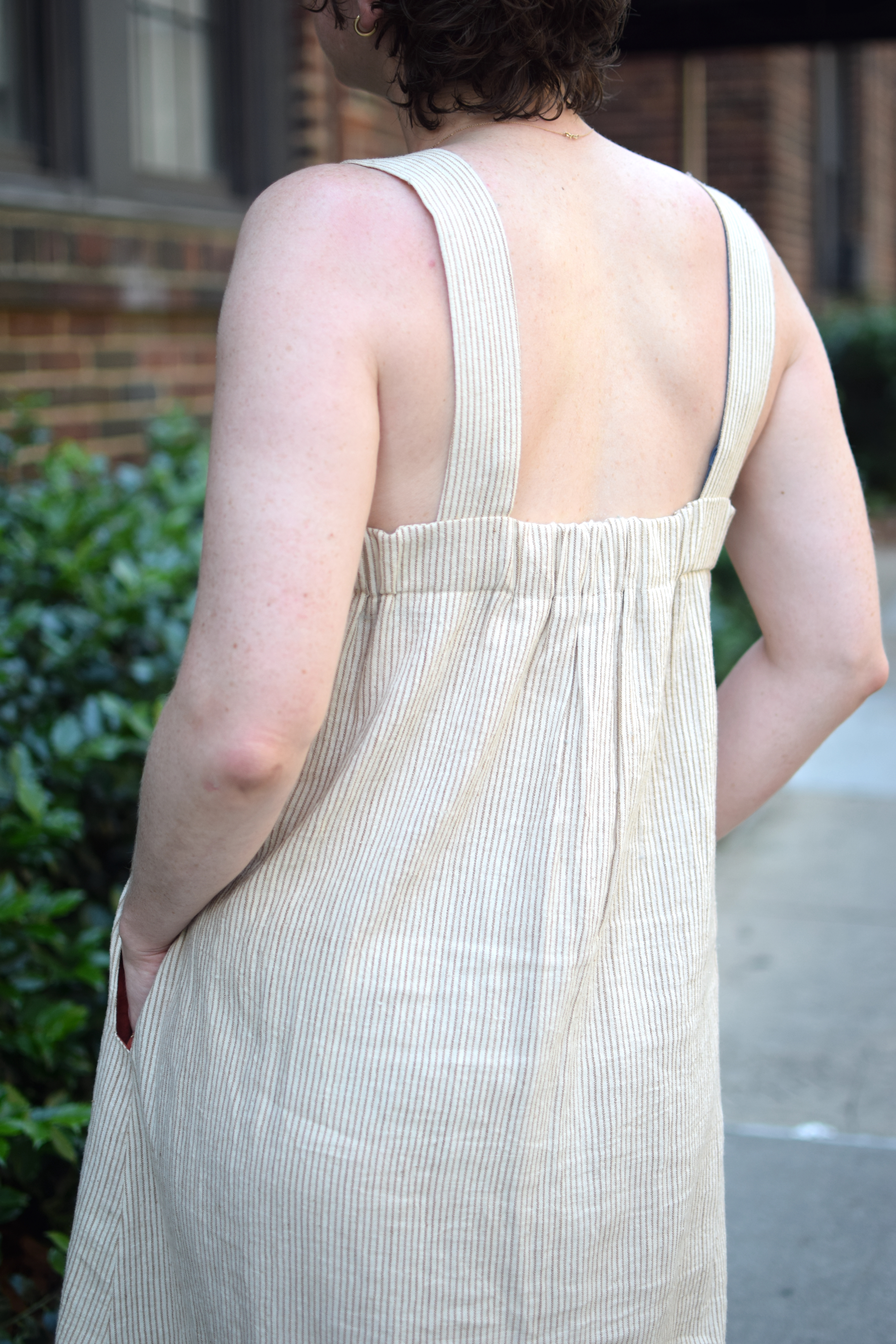 the back view of a brown and white striped dress.
