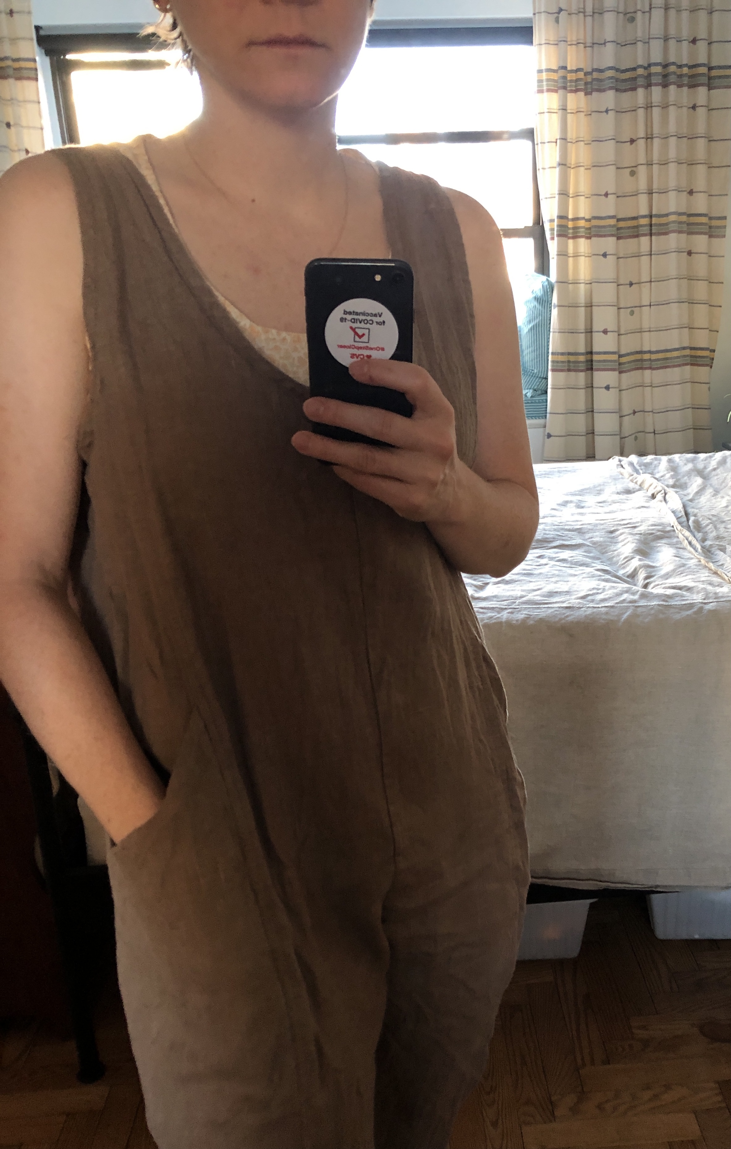 a selfie of a woman wearing a homemade jumpsuit