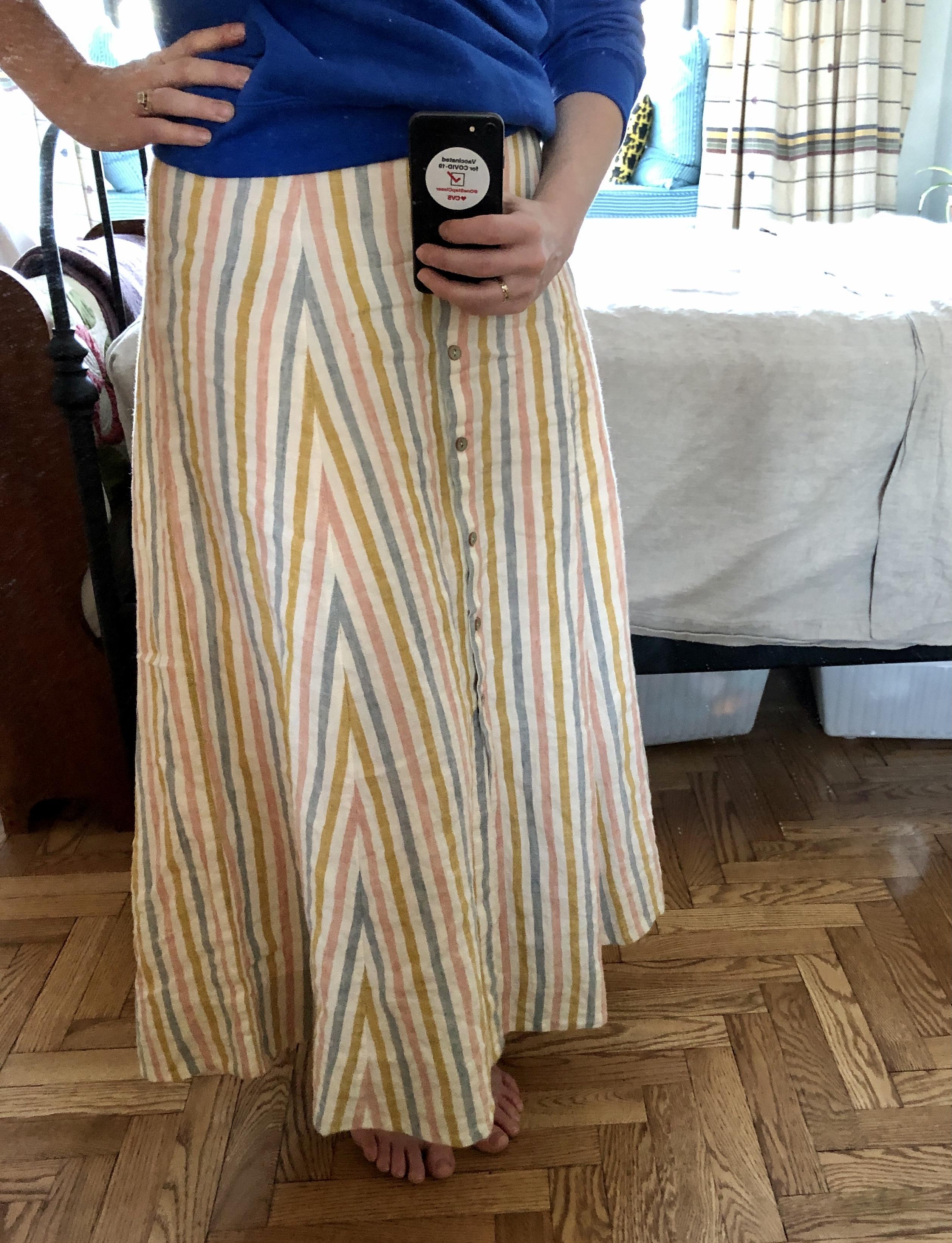 a selfie of a woman wearing a homemade striped skirt